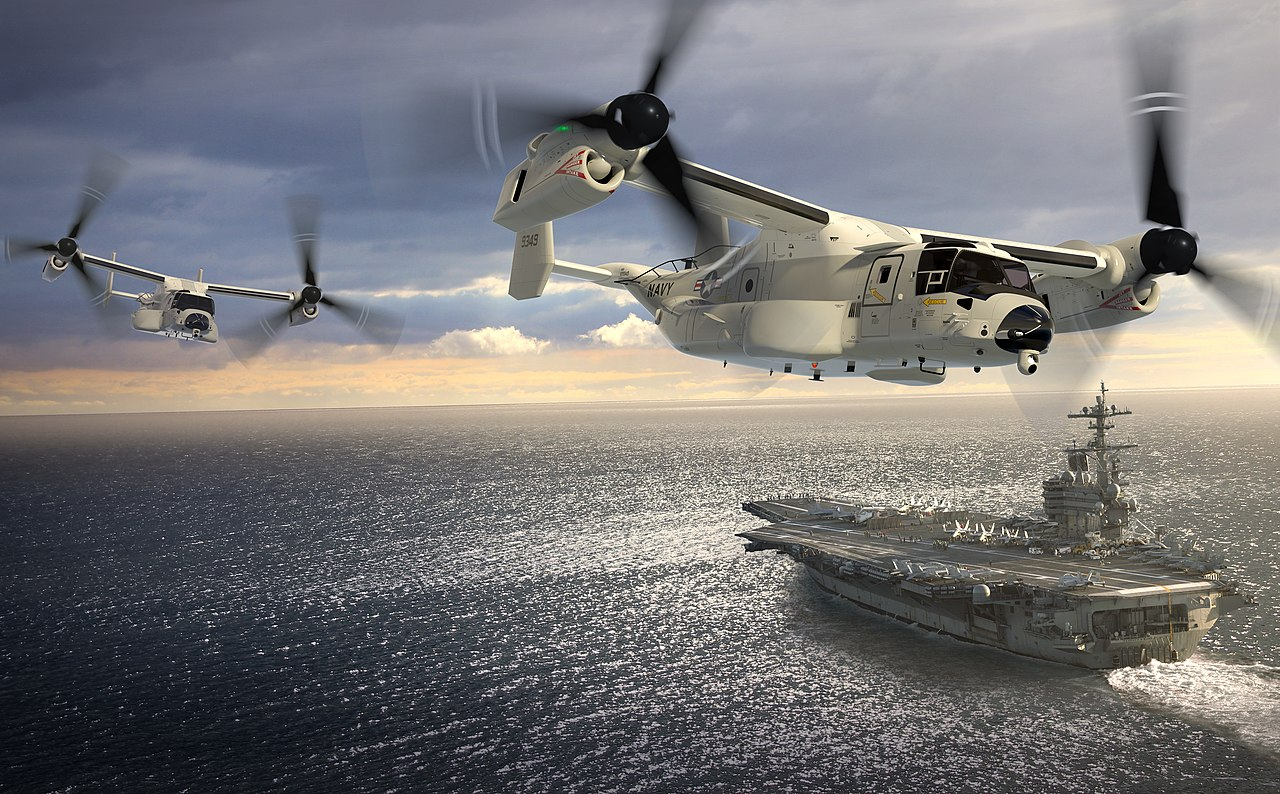 1280px-307399-03_-_artists_impression_of_a_pair_of_cmv-22bs_flying_past_uss_george_h